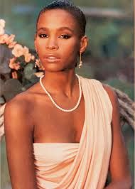 "This is the first image that many of us brown girls saw of Whitney Houston in 1985 in her self-titled debut, ""Whitney Houston"" -- a beautiful Black woman with short, natural hair. It was the 80s, and there were few images of natural hair in the music industry. It was all about the Jherri Curl back then, LOL. It would be later that we would hear THE voice."