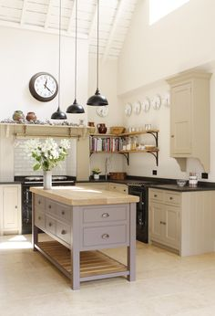We love this Christopher Peters kitchen for its subtle mix of country colours and the island in on-trend dusty pink.
