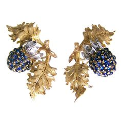 BUCCELLATI Sapphire Blackberry Ear Clips  Italy  Circa 1960  A pair of naturalistically modelled earrings in the form of balckberries, set with cabochon sapphires, and mounted in 18ct yellow gold. Signed Buccellati.