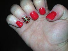 Red nails with cheetah print accent nail