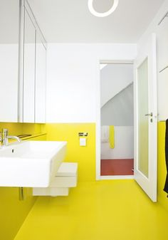 yellow bathroom floor is a bit much but like the inset sink and brightness of colour