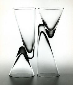 1983 Design: Achille Castiglioni 1983 Production: Danese Paro is the fruit of a careful study of glass shaping and production - glass blowing, break off, welding and grinding – regarding fine lead crystal (PbO 31.5%). The magic of master glass makers produces a drinking glass with two different capacities. Two cones, each inverted in respect to the other and joined near their vertexes as if they were sliding past each other, alternately become base or container