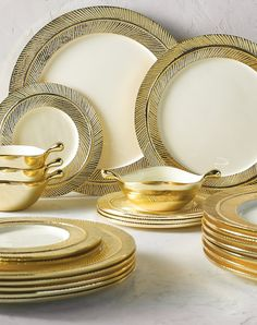 Opulence takes flight with lustrous, feathered dinnerware by Nima Oberoi Lunares. In artisan crafted sand-cast aluminum, gold plating and hand-painted enamel, the collection transforms an everyday meal into an exuberant special occasion.