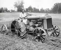 "Sept. 26, 1921. ""Ford tractor demonstration."" Another look at the plowing beeheld on the Washington, D.C., estate of former Maryland senator Blair Lee. A photo in the Washington Star identifies this young lady as ""Miss Myrtle Lewton of Takoma, Md., Golden Eagle Girl Scout who received her decoration from the Queen of Belgium."" National Photo Company glass negative. View full size."