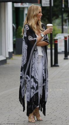 Glamorous: The blonde beauty was seen clutching a coffee cup as she indulged in a caffeine...