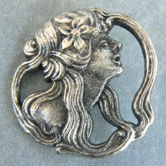 Profile art nouveau woman head, openwork white metal, newer button.