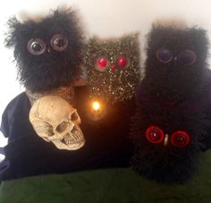 These black goth owls were made for those of you who like the dark Gothic style. They are hand knitted using eyelash wool and finished with button eyes and bead beaks... Giving each one its own individual expression  Each owl is 5 tall by 4.5 wide. PLEASE NOTE: These are decorative ornaments. for teenagers and adults, not toys. They are therefore not suitable for younger children due to small parts posing a choking hazard. Surface clean only, using damp cloth.