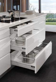 The Drawers are DTC tandem soft closing with an 18mm bottom and back with a white powder coat finish.  #Eurostyle #Modern #Gray #Cabinets #Kitchens #Homes #Homedecor #DIY #Remodel #Renovation #Luxury #Simplistic