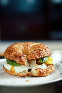 Poached eggs and avocado on a croissant   Toprocker via Flickr