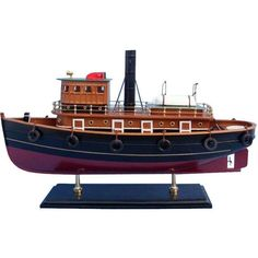 Wooden River Rat Tugboat Model NOT A MODEL SHIP KIT This Model Tugboat is Ready for Immediate Display Rule the harbor and keep your fleet in order with this mighty yet adorable tugboat model. Paying h Wooden Boat Building, Boat Building Plans, Model Ship Kits, Model Ships, Free Boat Plans, Jon Boat, Wood Boats, Tug Boats, Fishing Boats