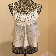 Free People Off-White Crop Top Very light feel, has adjustable straps in the back so that you can make it more or less cropped as you like. Free People Tops Crop Tops
