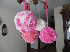 baby shower decor. styrofoam balls covered with cupcake liners, hanging over table.