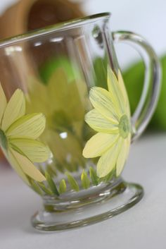 https://flic.kr/p/9BCF1n   Yellow daisy coffee or tea hand painted mugs   Hand painted wine glasses, martini, kitchen and more.  Top rack dishwasher safe and comes with a care tag so people know this.  Personalization is FREE of charge.  Wholesale pricing for private orders available.