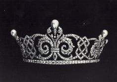 A beautiful diamond and natural pearl belle epoque tiara, circa 1900, possibly by Boucheron. Designed as five stylised fleur de lys, each topped by a natural, pear-shaped upright pearl, held in place by foliate leaves; with diamond scroll and knot-work links, on a diamond band.