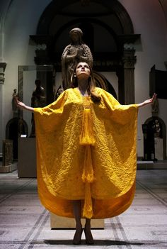 Model Bianca Gavrilas wears a hand-embroidered cape made from the silk of the Golden Orb Spider in the V&A Museum designed by Simon Peers