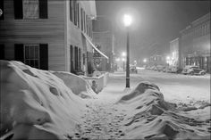 Center of town. Woodstock, Vermont. Snowy night 1940 poster print