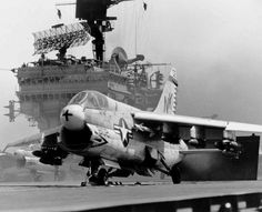 A Corsair on deck of USS Constellation, loaded with bombs.