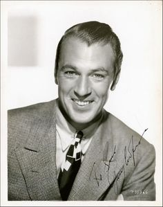 Gary Cooper in a tweed jacket and printed silk tie