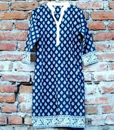 Blue kurti with white motifs..