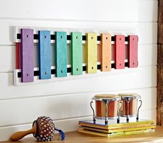 """(I can make this!) Jumbo Wall Xylophone $89 Create a child's music corner with this popular instrument, supersized and brightly painted for an unusual wall accent. 36"""" wide x 11"""" high x 1.25"""" thick Expertly crafted of wood."""