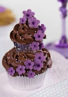 Two Tiered Cupcakes with Brown Frosting and Purple Flowers