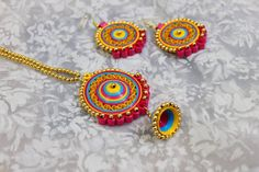 Unknown Artist Paper Quilling Earrings, Quilling Craft, Quilling Patterns, Thread Jewellery, Paper Jewelry, Paper Beads, Rakhi Making, Handmade Rakhi, Terracotta Jewellery