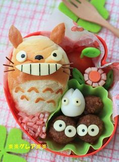 Totoro bento -  An oblong roll as Totoro, I've never seen that one before. clever way to make sandwiches into totoro bento!