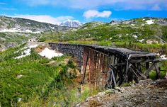This epic rail bridge was built for the gold rush but now sits abandoned, with only the mountains for company.    Visit by all means, but you should definitely not walk out on it!