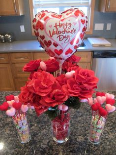 Romantic Centerpiece With Beautiful Heart Shaped Happy Valentine's Day Balloon And Wonderful Red Flowers On Glass Holder For Dazzling Valentine's Day Balloons Decorations To Embellish Valentine's Party