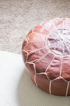 A brown leather pouf: http://www.stylemepretty.com/living/2016/04/12/color-happy-home-that-pantone-would-drool-over/ | Photography: Kate Osborne - http://kateosbornephotography.com/index2.php#!/h_o_m_e