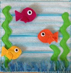 Animal Quiet Book: Fish Page. Fish slide across page. Made by @SoKnitpicky. Base: Peltex 70, illusion. Materials: ric rac for kelp, illusion trim for sea floor, ribbon, felt. Inspired by http://www.youcanmakethis.com/products/toys-activities/under-the-sea-quiet-book.htm