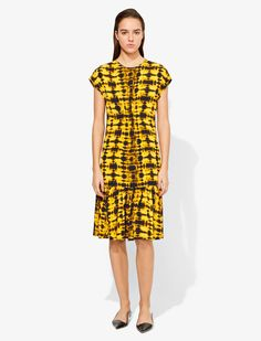 Yellow Tie Dye Short Sleeve Dress from Proenza Schouler featuring a round neck, a fitted silhouette, a rear zip fastening, a knee length, a ruffled hem and cap sleeves. Yellow Ties, Yellow Black, Short Sleeves, Short Sleeve Dresses, Dresses With Sleeves, Cap Sleeves, Tie Dye Shorts, Proenza Schouler, Fitness Models