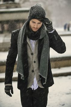 Shop this look on Lookastic: http://lookastic.com/men/looks/beanie-scarf-longsleeve-shirt-blazer-pea-coat-jeans-gloves/4141 — Black Beanie — Charcoal Scarf — White and Red Vertical Striped Long Sleeve Shirt — Brown Wool Blazer — Black Pea Coat — Black Jeans — Black Horizontal Striped Wool Gloves