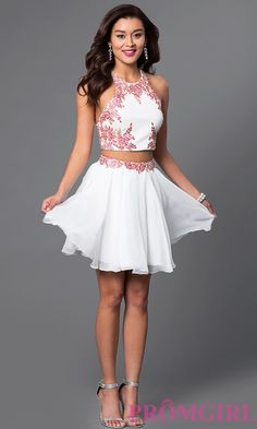 Two piece homecoming dress with beaded applique, corset top, and adjustable straps that criss-cross on the back.