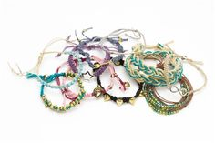 Cord Jewelry Kit - You will enjoy the variety of bracelets styles found within this cord bracelet kit. Learn interesting techniques to create enough bracelets to share, all with designer details that everyone will be asking for. You will receive metal connectors and glass beads in each kit that pair well with natural colored cording in assorted braids. You can make the 10 bracelets pictured by following the detailed instruction sheet provided for you. [$9.99]