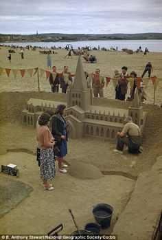 Sands of time: People watch a sculptor build a miniature cathedral on Weymouth beach, Dorset. Sand artists still make incredible creations on Weymouth beach today. Life Is Like, What Is Life About, Weymouth Bay, Old Photos, Great Photos, Dorset Beaches, Sand Sculptures, Sculpture Art, Jurassic Coast