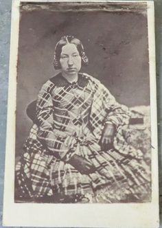 Woman wearing a lot of plaid