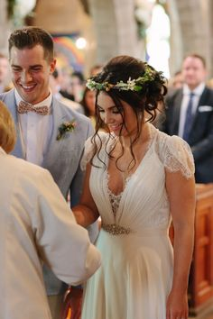At the altar in church - bride wears Dentelle by Jenny Packham and a floral crown, the groom wears a pale blue Paul Smith jacket and bow tie.  http://www.lauramccluskeyphotography.com/