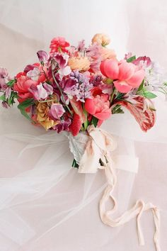 There's something about a pink bridal bouquet that really anchors a pink color palette or accent color on the big day. 💗 This vivid assortment created by LBB floral designs @bowsandarrowsflowers boasts unbelievably beautiful hues for the ultra-romantic bride. It's guaranteed to pop against any bride's white wedding dress! 🌸 | LBB Photography: @kellyhornberger #stylemepepretty #pinkbouquet #weddingflowers #pinkwedding Bridal Bouquet Pink, Wedding Bouquets, Wedding Flowers, White Wedding Dresses, Floral Designs, Anchors, Spring Wedding, Wedding Signs, Pink Color