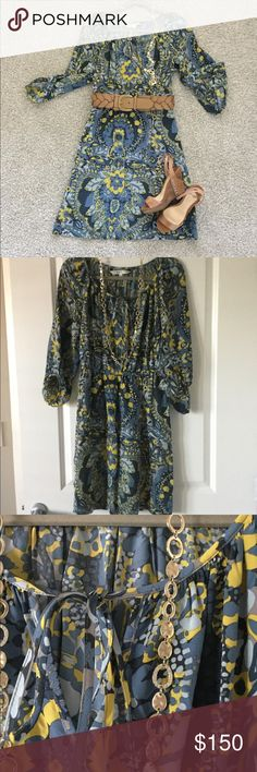 Trina Turk silk dress. Gorgeous silk dress by Trina Turk.  Elastic at the waste looks great with a belt and boots or sandles. Different color greys and blues with yellow accents. Ties at the neckline. Size 2. 100% silk. Never worn. Trina Turk Dresses