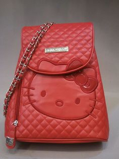 Red quilted backpack with chain straps