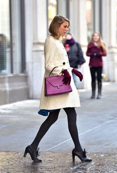 Leaving her apartment in February 2015. See Taylor Swift's full fashion evolution, from sequins in 2007 to her many crop tops today