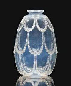 Lalique vase of opalescent intaglio glass designed 1925