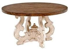 A beautiful ornate scroll base is paired with a distressed wood top for a unique rustic table for Tuscan, Old World, Spanish or Mediterranean decors. Kitchen Table Chairs, Dining Table Design, Round Dining Table, Dining Room Table, Tuscan Dining Rooms, Best Kitchen Colors, Contemporary Dining Chairs, Tuscan Decorating, Rustic Table