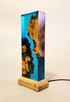 Live edge wood and ocean blue epoxy table/mood lamp with glowing effects – wood sculpture – wooden lamp – wood and epoxy art – table lamp – Harz – abepoxy Diy Resin Crafts, Wood Crafts, Live Edge Tisch, Epoxy Resin Wood, Mood Lamps, Live Edge Wood, Wooden Lamp, Wood Sculpture, Wood Art