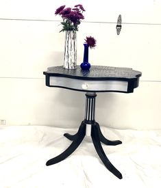 I repurposed this antique table with a black and silver shine with lots of attention to detail.  I used an alligator print stencil on the top to give it lots of texture.