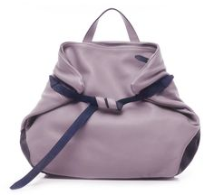 The Small Emma bag by ro presents an origami like sculptural shape that is quite unique and a new look for ro this season.  Other interesting details  are the lavender/grey leather mix with navy trim....
