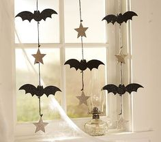 I love the Boo Bats & Stars Garland on potterybarnkids.com - this looks like it would be easy to DIY