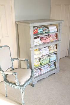 Drawer-less dresser turned fabric storage or towel storage for a bathroom. Not a bad idea.