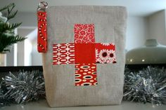 First aid kit in a cute zippered bag -- got to keep this idea in mind for next Christmas!